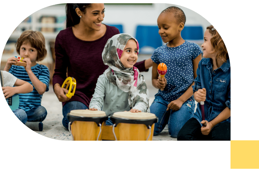 music teacher playing instruments with a group of young children