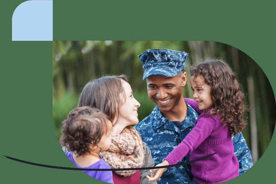 veteran father hugging his family