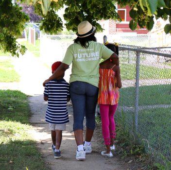 future homeowner family walking down sidewalk
