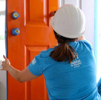 volunteer painting door