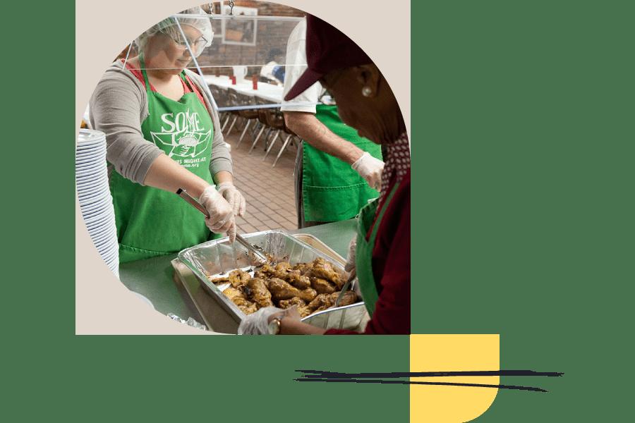 volunteers preparing wings to hand out