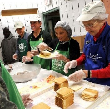 volunteers preparing sandwiches together