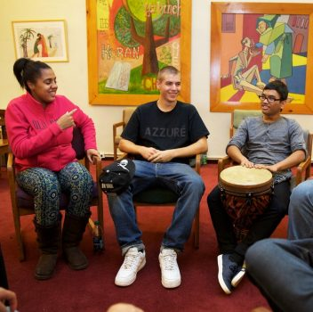 youth group engaging in conversation and music