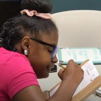 child filling out a worksheet