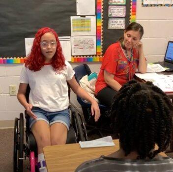girl speaks to classroom